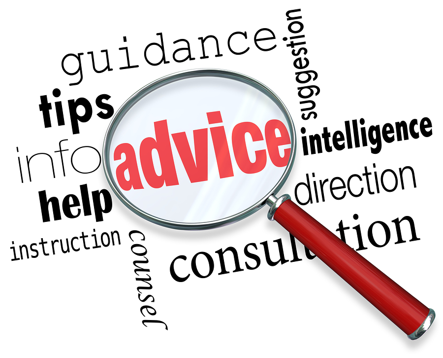 Advice word under a magnifying glass to illustrate searching for and finding support, tips, guidance, service, information, help, instruction and direction