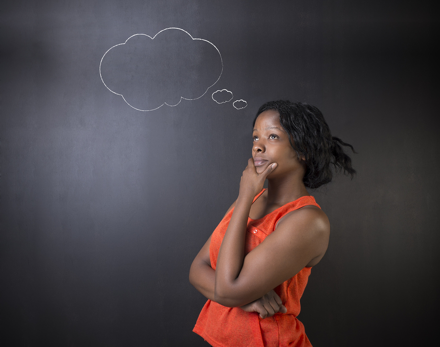 South African or African American woman teacher or student thinking with thought clouds