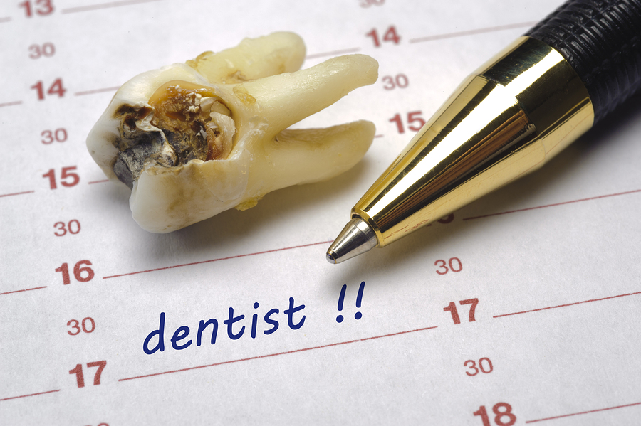 dentist date in calendar and tooth with dental caries