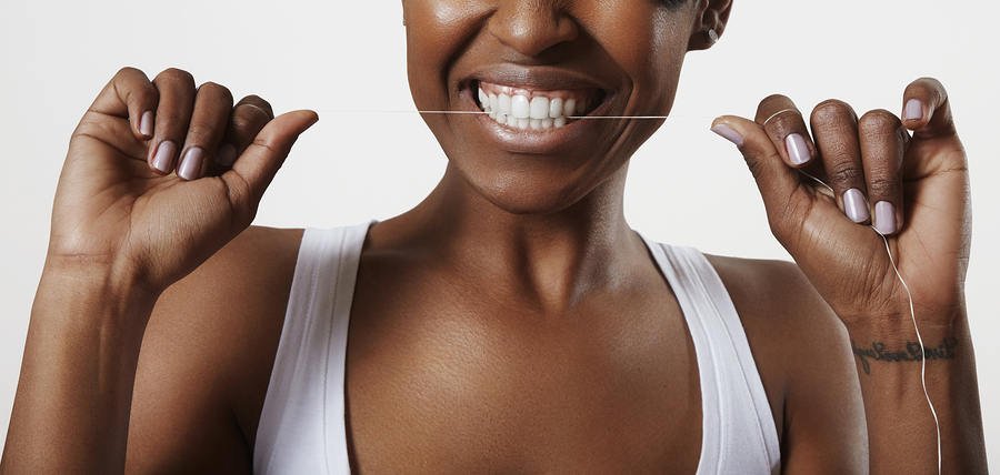 woman with a dental floss. Bite a floss