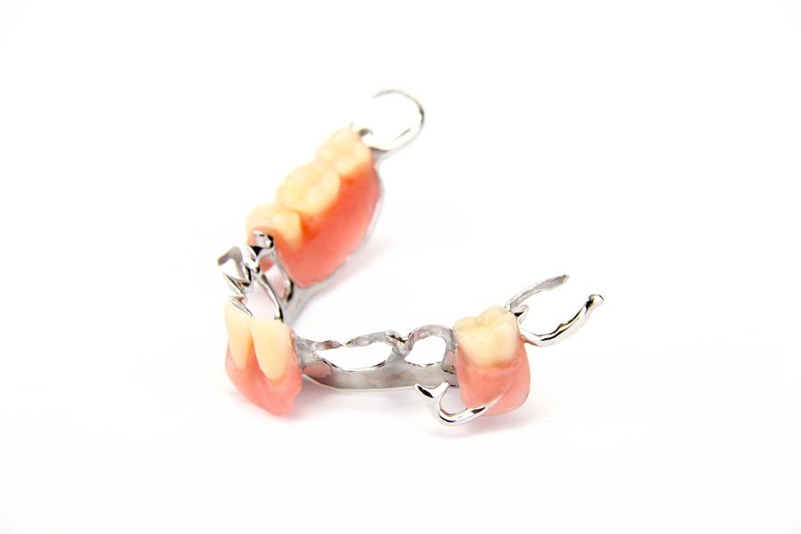 Artificial teeth on white background. Denture, Crown, Bridge